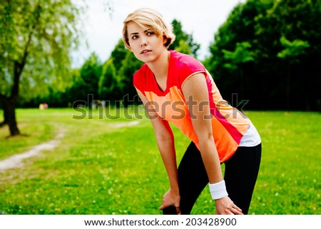 Photo of a young female runner getting ready for a park run - stock photo