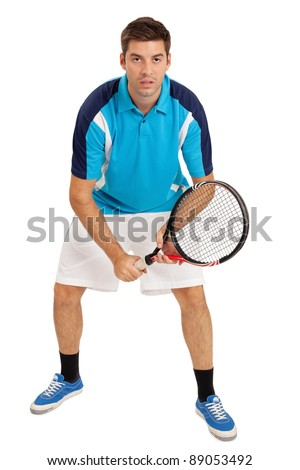 Photo of a young man playing tennis over white background. - stock photo