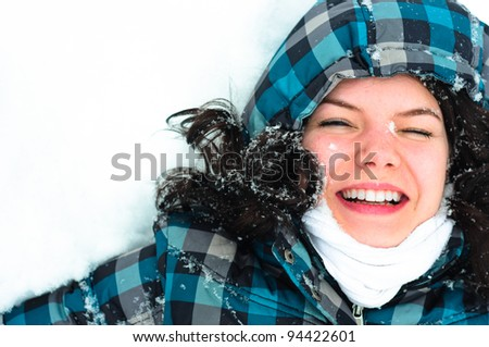 Photo of a young woman in the snow - stock photo