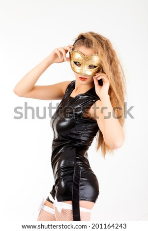 Photo of a young woman wearing mask isolated on a white background