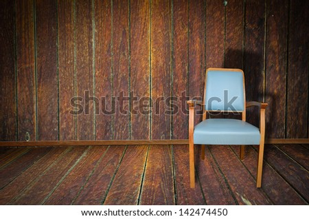 Photo of abstract grunge shabby interior with single chair, copyspace