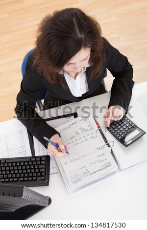 Photo Of Accountant Woman Working In Office - stock photo
