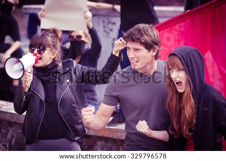 Photo of active young participants of street demonstration - stock photo