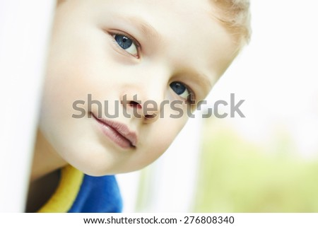 Photo of adorable young happy boy looking at camera. Outdoor face of child - stock photo