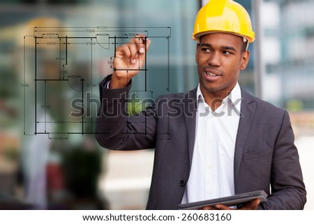 Photo of African construction engineer drawing with a digital pen - stock photo