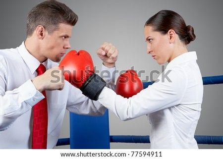 Photo of aggressive business partners fighting with each other - stock photo