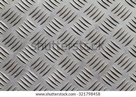 Photo of aluminium dark list with rhombus shapes - stock photo
