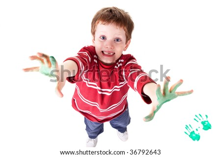Photo of an adorable child playing with paint. - stock photo