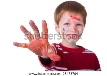 Photo of an adorable child playing with paint. Focus on hand.