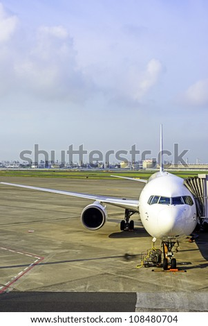 Photo of an airplane at the airport on the tarmac - stock photo
