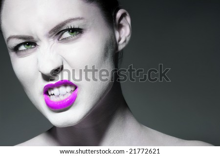 photo of an angry girl on gray background