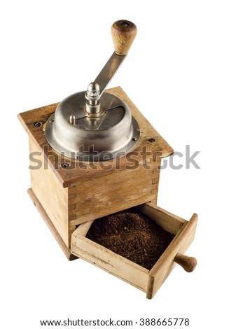 Photo of an antique coffee grinder isolated on a white background - stock photo