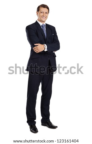 Photo of an attractive businessman with his arms crossed and smiling over a white background. - stock photo
