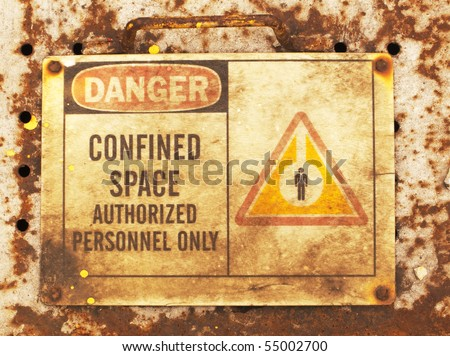 photo of an old confined space sign - stock photo