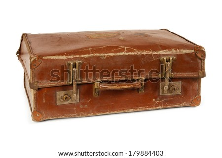 Photo of an old leather suitcase over a white background.