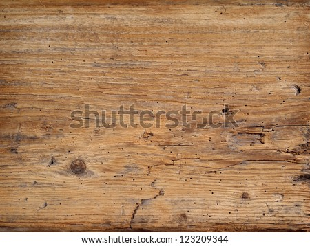Photo of an old wood plank taken from a rotting barn. - stock photo