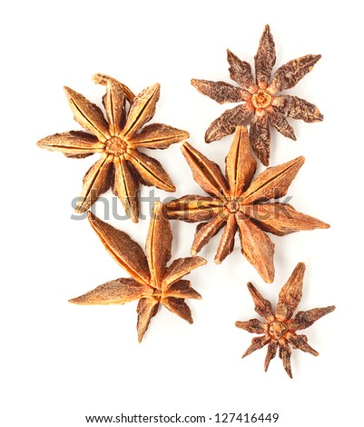 Photo of anise stars on a white background