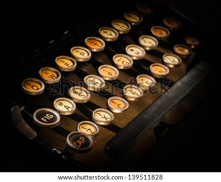 photo of antique typewriter keys, shallow focus and vintage look - stock photo