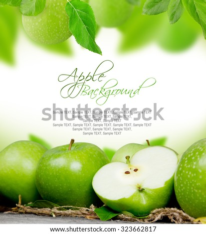 Photo of apples with leaves on burlap with white space