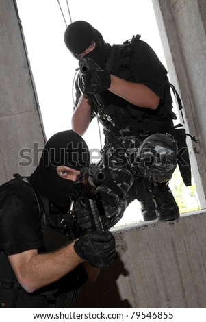 Photo of armed men in combat uniform playing terrorist or special forces team members