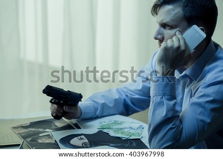 Photo of armed secret agent and conspiracy theory - stock photo