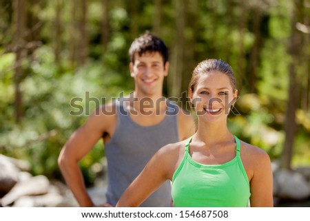 Photo of athletic couple in the mountains with running outfit - stock photo