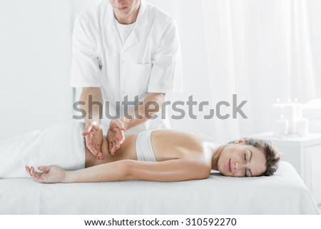 Photo of attractive female pampering her body in day spa - stock photo