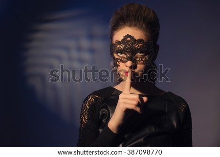 Photo of attractive woman expression silent, picture of mysterious girl show hush gesture, closeup portrait of young mum sign shh, image of female with finger near lips, concept of silence - stock photo