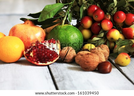 Photo of autumn fruits on wooden background - stock photo