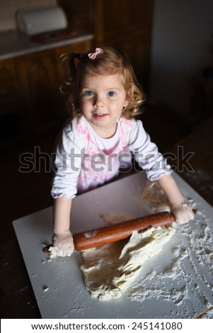 photo of  baker adorable, pretty little caucasian girl in chef. Cooking concept.  - stock photo