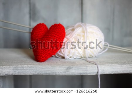 Photo of ball of wool and heart on wooden background - stock photo