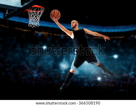 Photo of basketball player makes layup in the game. . Basketball game. Sportsman plays basketball. - stock photo
