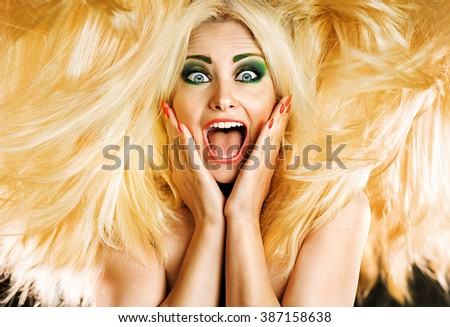 Photo of beautiful blonde woman with magnificent hair - stock photo