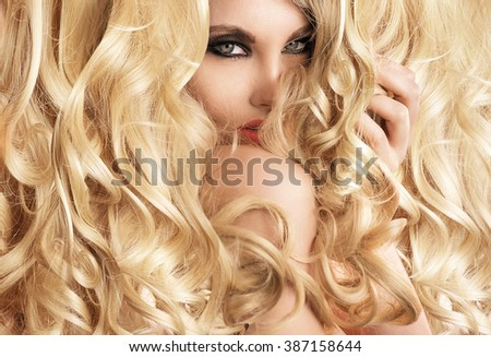 Photo of beautiful blonde woman with magnificent hair