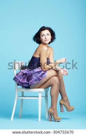 photo of beautiful innocence girl on blue backround