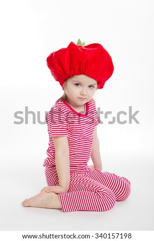 photo of beautiful little girl with tomato hat