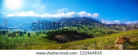 Photo of beautiful mountain landscape, natural background, blue sky with bright sun light, fresh air, green pasture valley in Lebanon mountains, scenic place, traveling and active vacation concept - stock photo