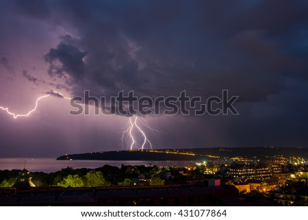 Photo of beautiful powerful lightning over big city, zipper and thunderstorm, Varna. Bulgaria