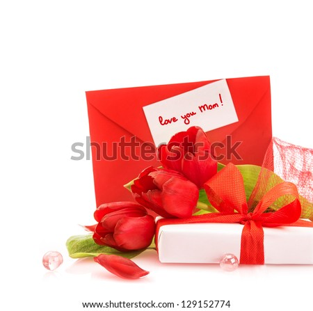 Photo of beautiful romantic still life for mothers day, fresh red tulips, gift box, holiday greeting card, festive border, copy space, present for mom, floral bouquet, spring season, love concept - stock photo