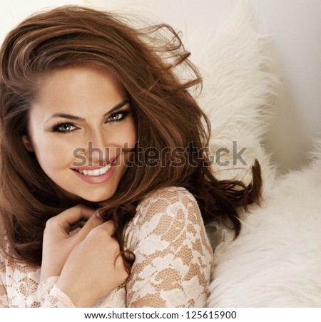 Photo of beautiful smiling lady with amazing eyes - stock photo
