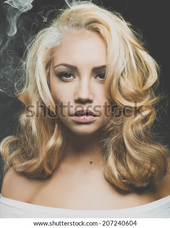 Photo of beautiful woman with magnificent blond hair - stock photo