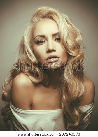 Photo of beautiful woman with magnificent blond hair. Hair Extension, Permed Hair - stock photo