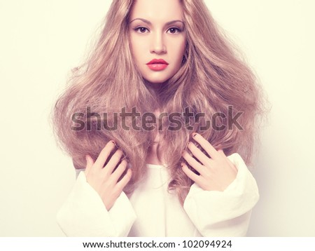 Photo of beautiful woman with magnificent hair - stock photo