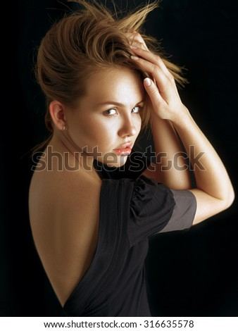 Photo of beautiful woman with original hairstyle on black background - stock photo