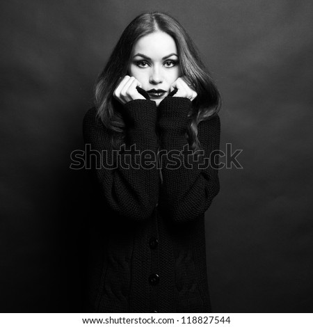 Photo of beautiful young woman in knitted sweater. The Black-and-white photo