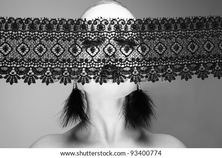Photo of beautiful young woman with lace. The Black-and-white photo