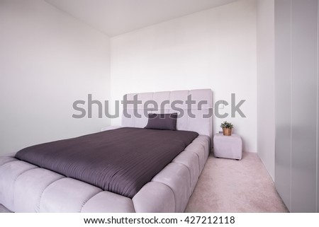 Photo of beige and brown bedroom with big comfortable bed