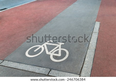 Photo Of Bicycle Lane Across The Road - stock photo