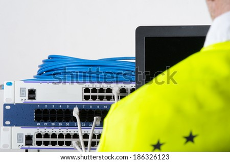 Photo of big server and wires during check-up
