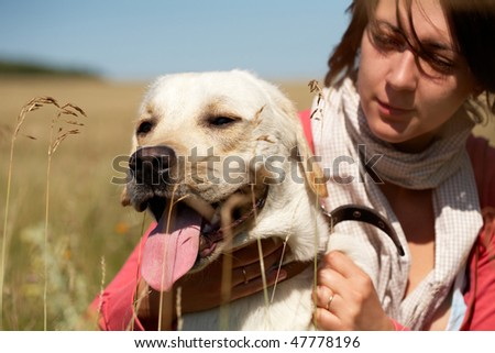 Photo of big white dog with its master in the open air - stock photo